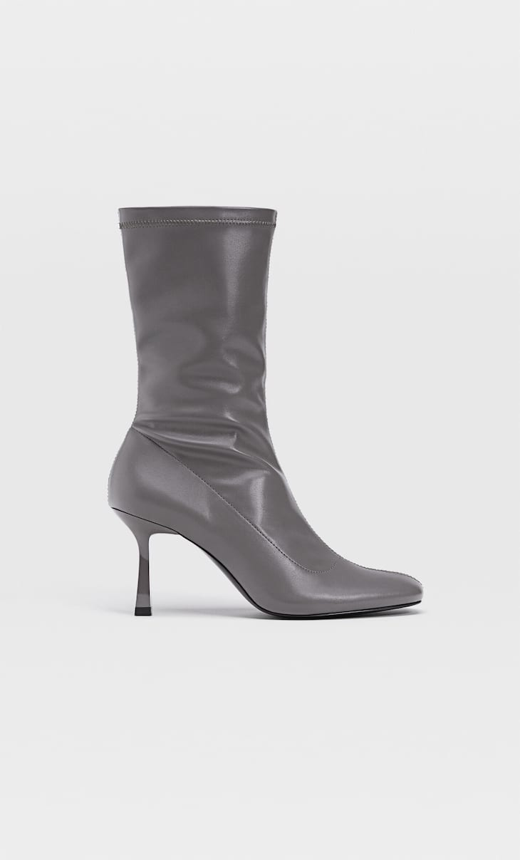 Stiletto heel boots with stretch legs