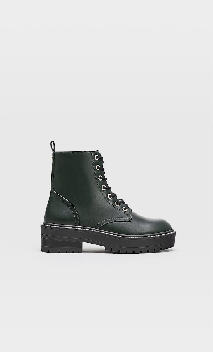 Flat green ankle boots with double laces