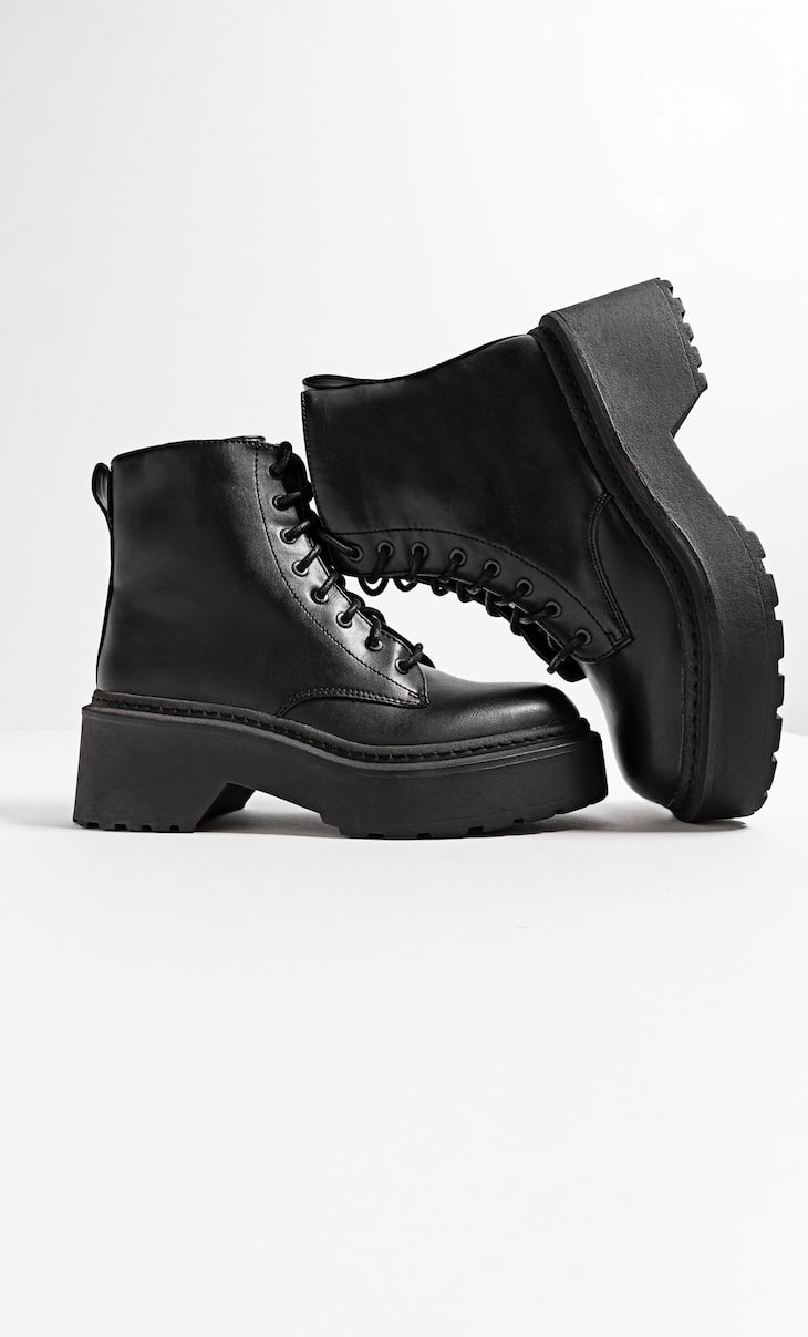 Black lace-up ankle boots with extra-chunky soles