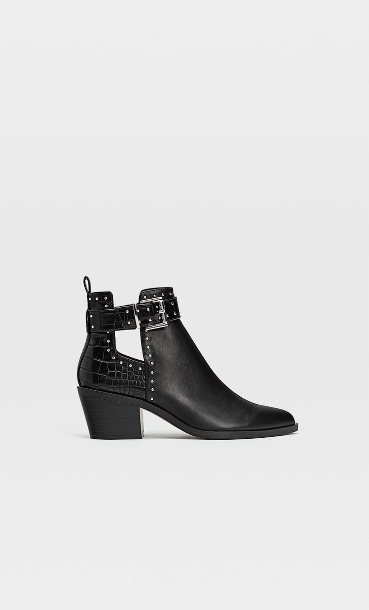 Bottines cut out cloutées