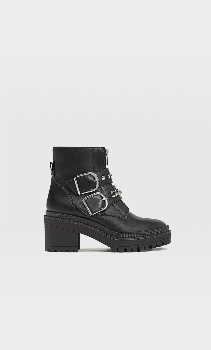 Ankle boots with track soles and zip with chain detail
