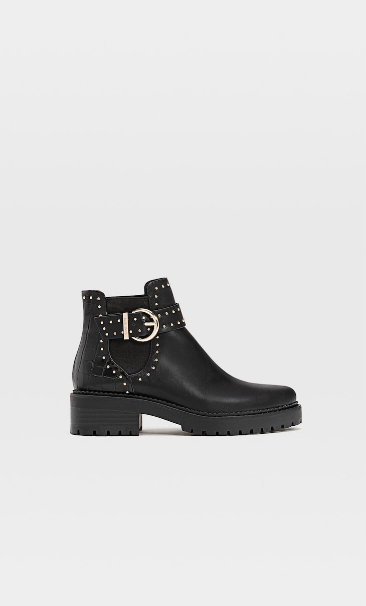 Flat ankle boots with studs and track soles