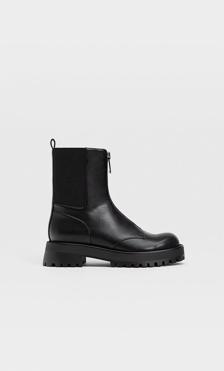 Flat ankle boots with track sole and zip