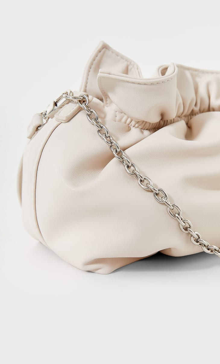 Crossbody bucket bag with chain