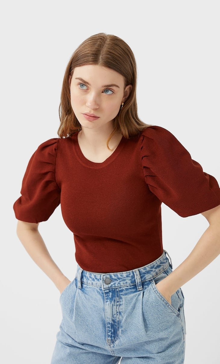 Tricot trui met detail op mouw