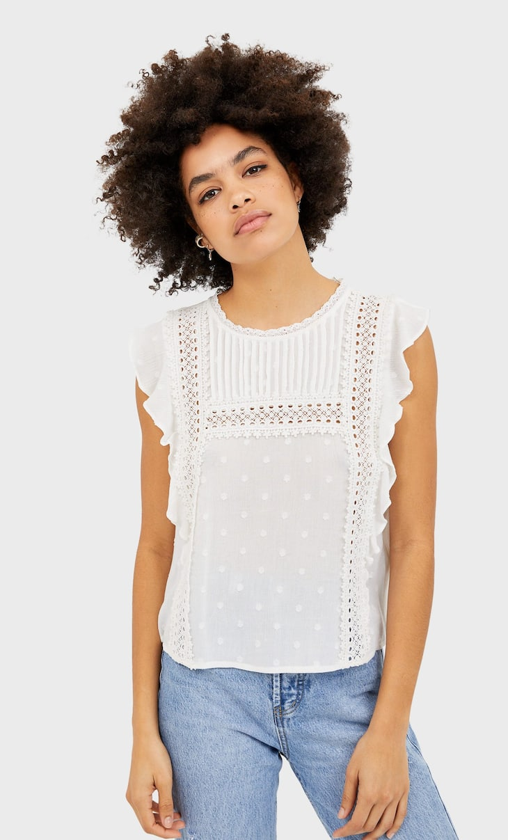 Ruffled Swiss dot and crochet blouse