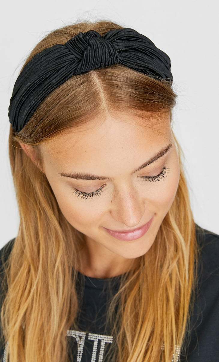 Pleated rigid headband