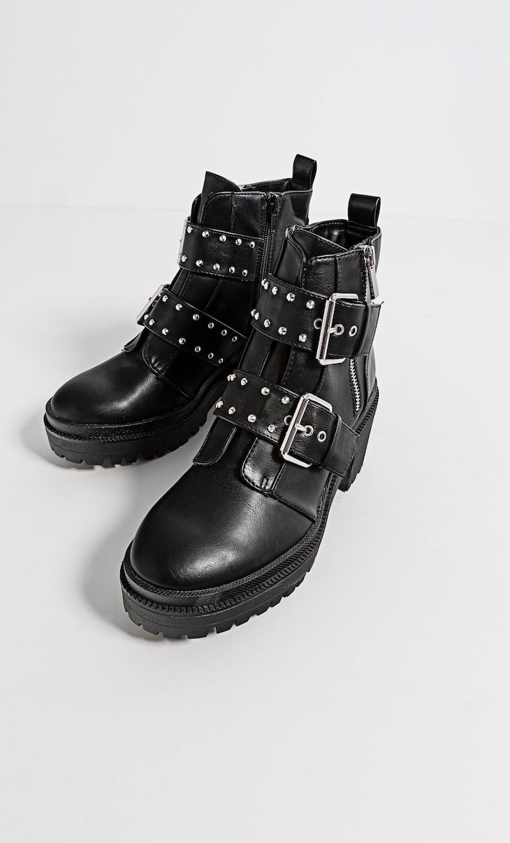 Ankle boots with track soles and buckle details