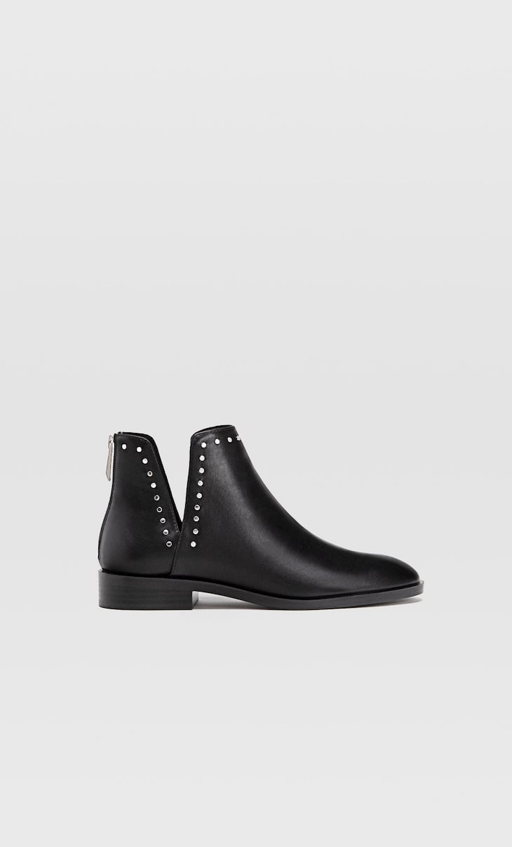 Flat cut out ankle boots with studs