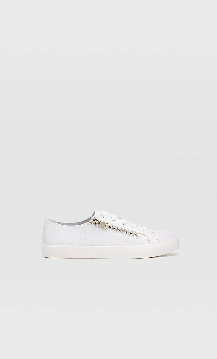 White trainers with zip detail