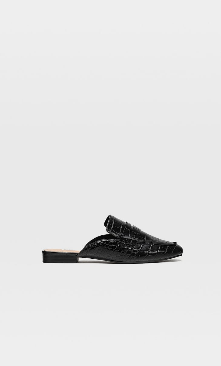 Embossed black mule loafers