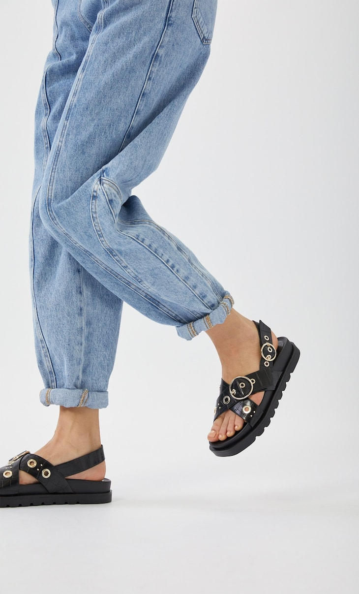 Embossed flat sandals with buckles