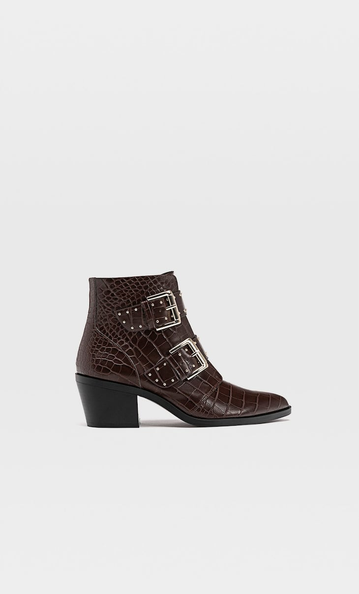 Embossed brown heeled ankle boots with buckles