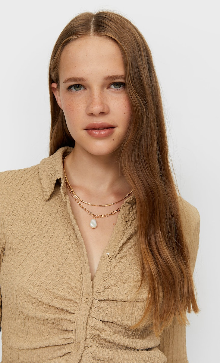 Set of 4 chain and faux pearl necklaces