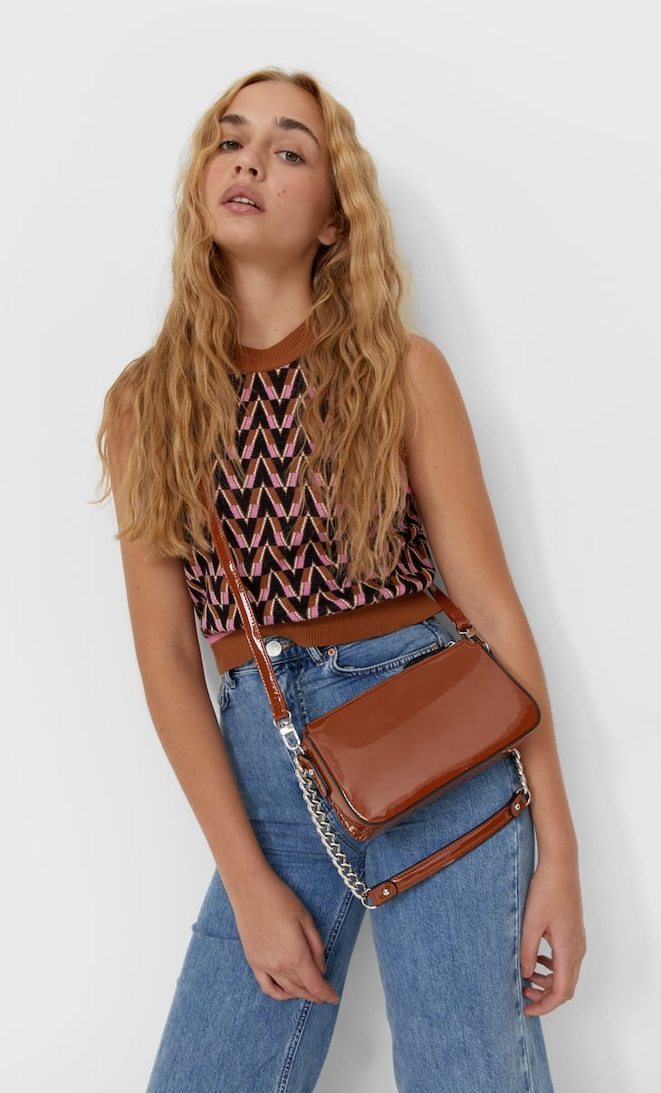 Faux patent crossbody bag with chain detail