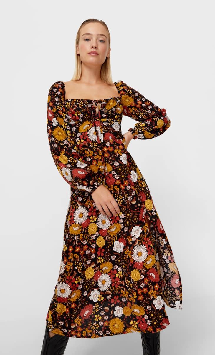 Srednje dolga obleka s cvetličnim potiskom