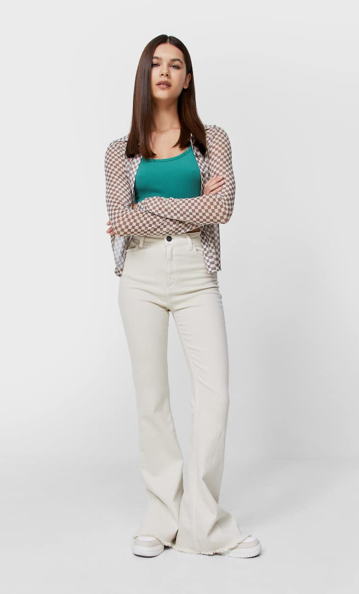 Flared trousers with side slit