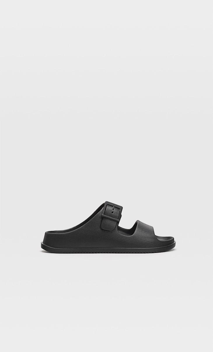 Flat rubberised sandals