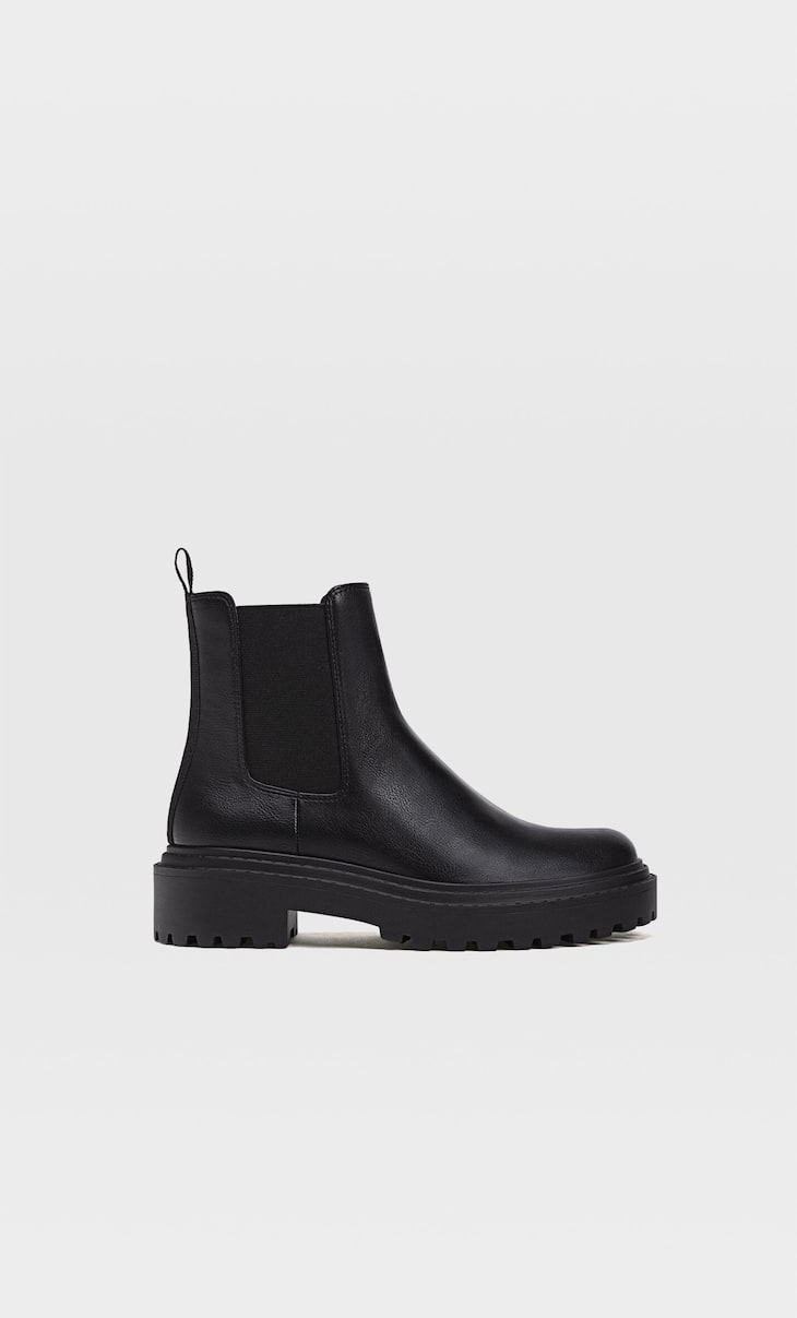 Flat ankle boots with track soles