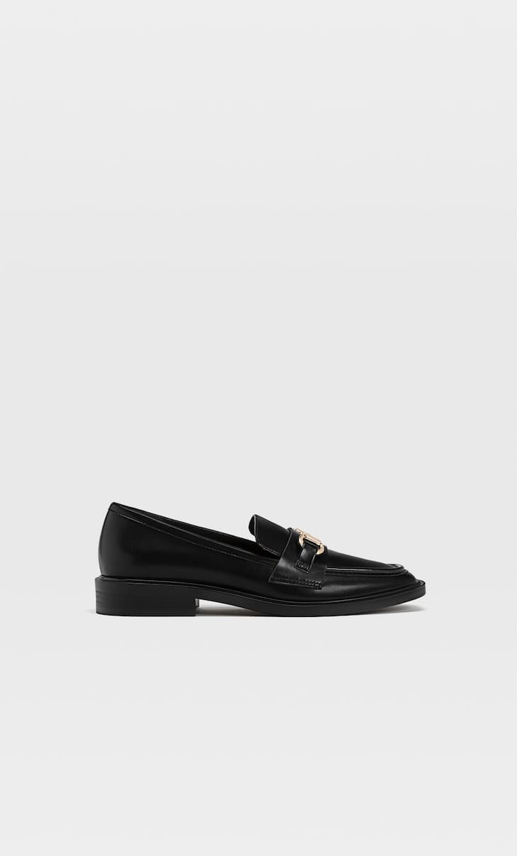 Black loafers with buckle detail