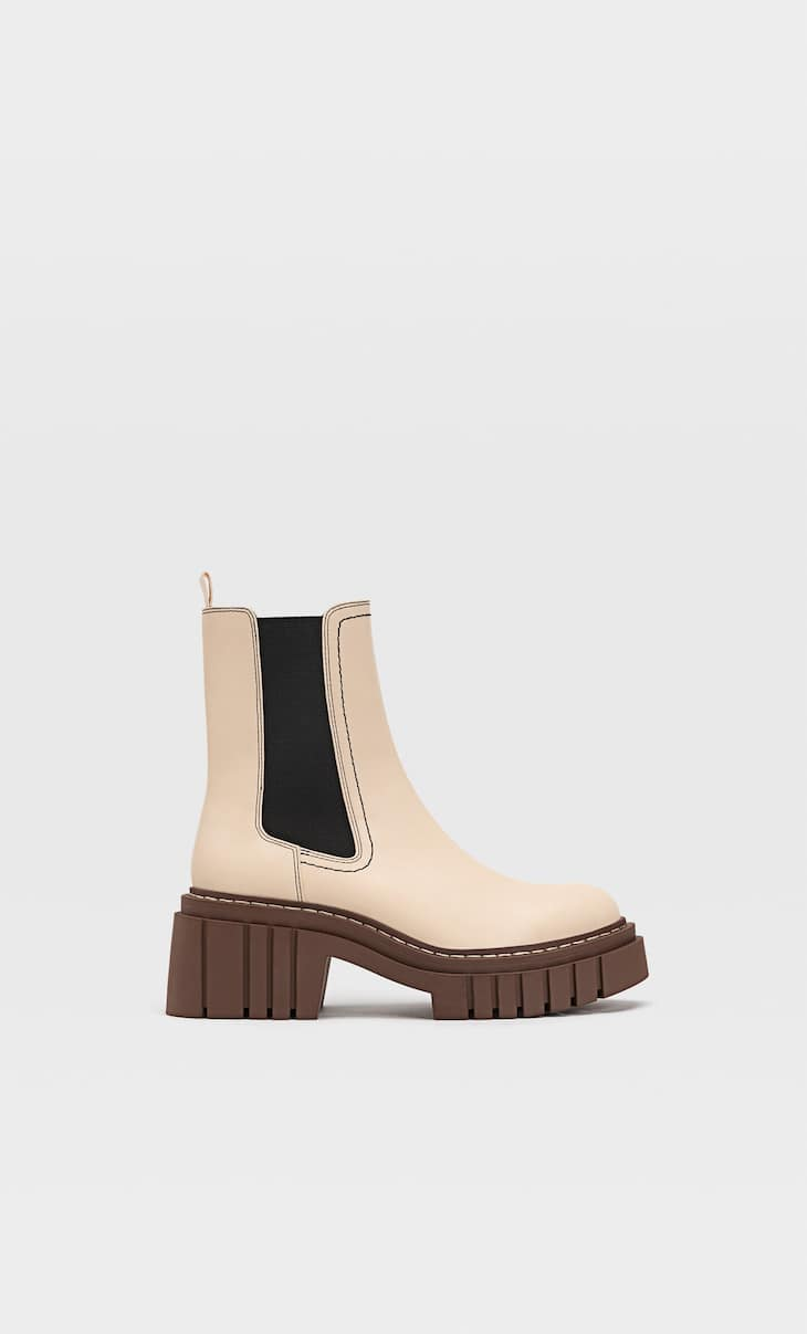 Stretch ankle boots with track soles
