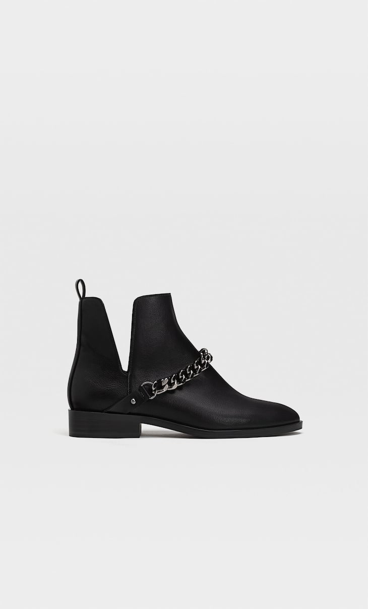 Black vented flat ankle boots