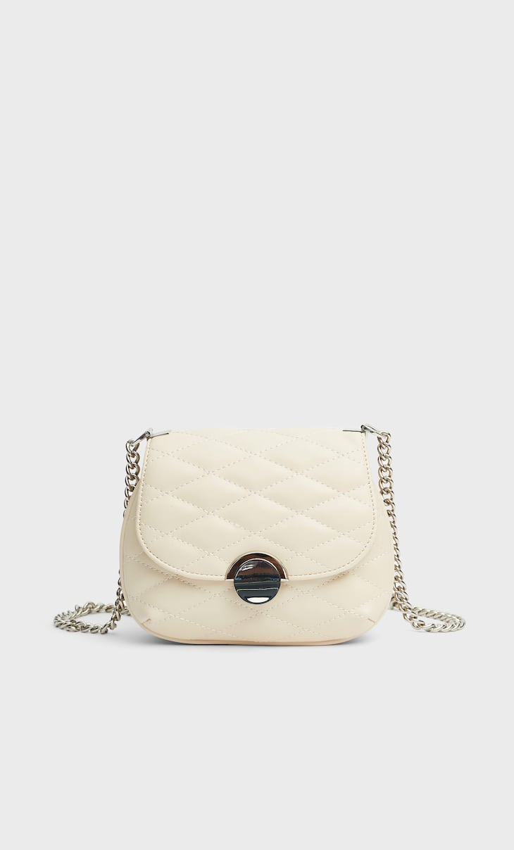Quilted crossbody bag with fastening