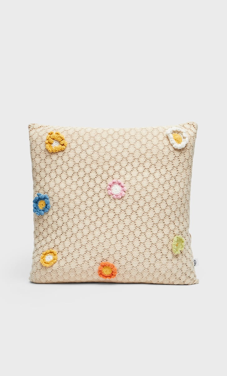 Crochet cushion cover with patches