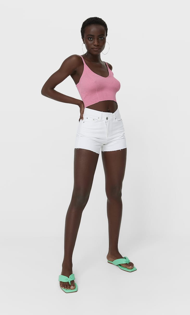 Denim shorts with asymmetric waistband