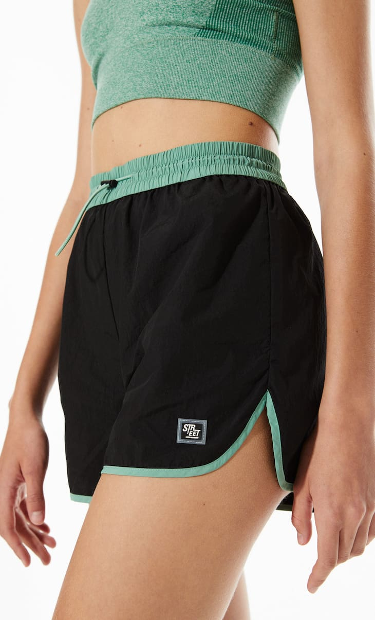 Technical shorts with coloured waistband