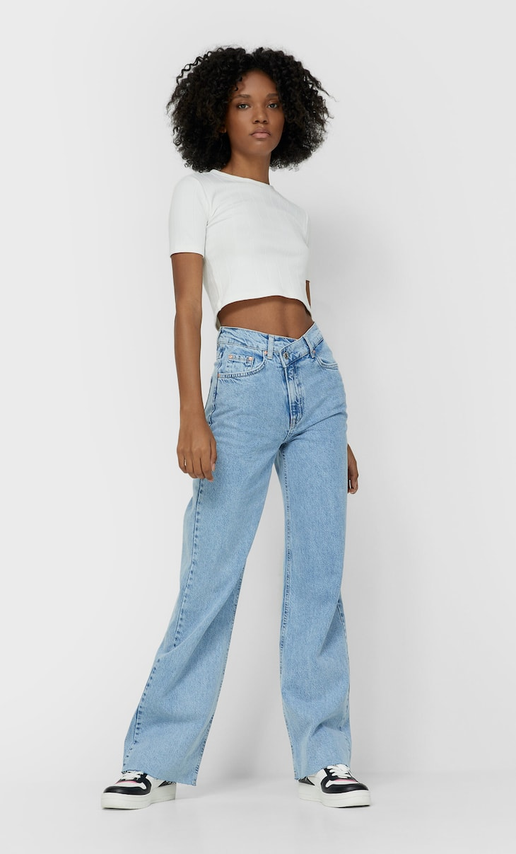 Straight fit jeans with asymmetric waistband