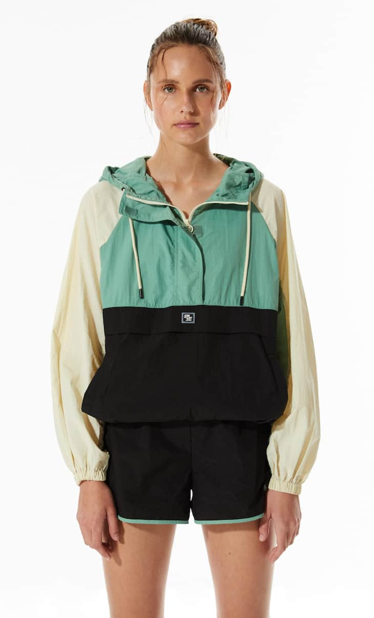Technical jacket with pouch pocket