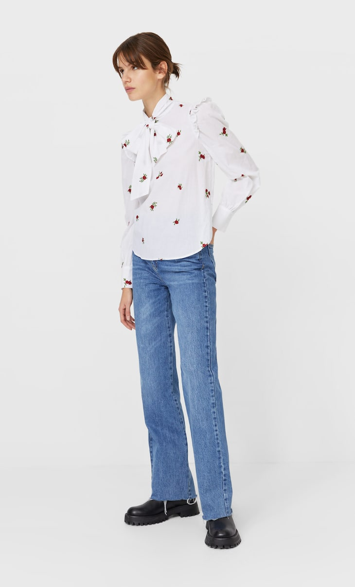 Embroidered blouse with bow