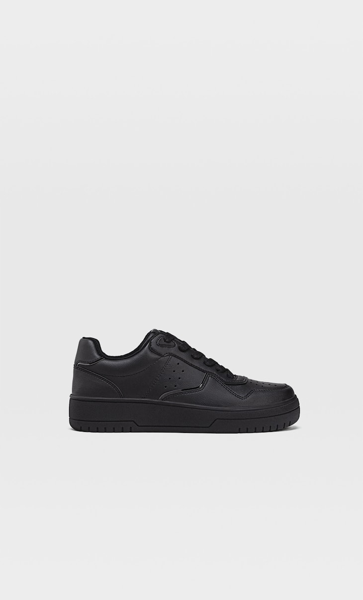Black trainers with piece details