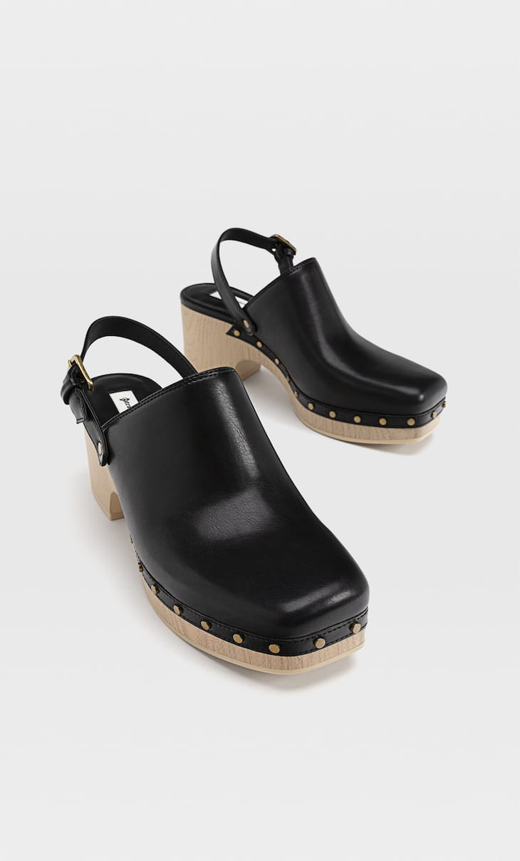 Wooden-heel clogs with stud detail